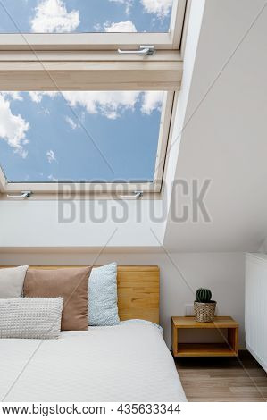 Concept Of Morning Light In House. Vertical View Of Clean Skylight In White Bedroom Interior. Modern