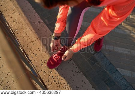 Top View Close Up Crop Of Sporty Active Fit Girl Lace String Athletic Trainers Get Ready For Jog Or