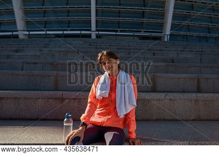 Portrait Of Smiling Active Toned Millennial Girl Rest On Stairs Do Sports Fitness On Street. Happy S