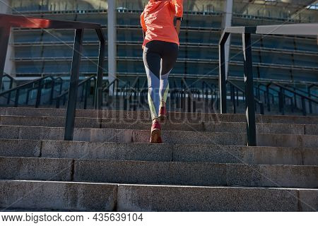 Low Angle Crop Of Sporty Toned Woman In Sportswear Run Jog On Stairs Outside. Active Female Runner S