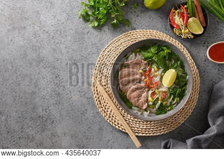 Pho Bo Soup With Beef In Gray Bowl On Gray Backgound. Vietnamese Cuisine.