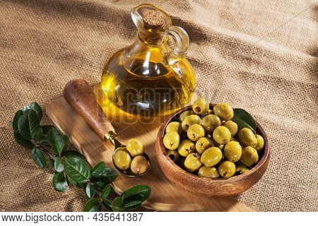 Green Olives And Olive Oil On The Table