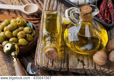 Olive Oil And Olives In A Rustic Style.