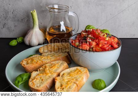 Fried Crispy Ciabatta Slices Sprinkled With Grated Cheese For Tomato Bruschetta