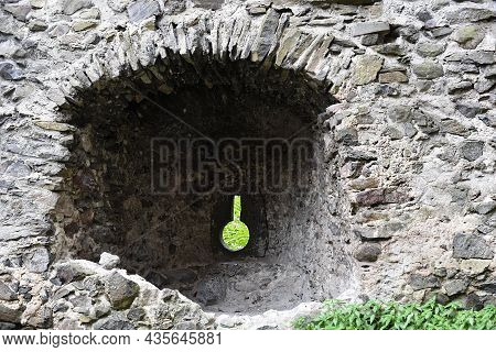 Mystical Ruins. Facade Of An Abandoned Ruined Building Of An Ancient Castle. Old Stone Walls. Horror