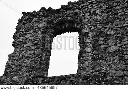 Mystical Ruins. Window On The Facade Of An Abandoned Ruined Building Of An Ancient Castle. Old Stone
