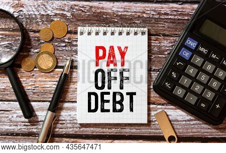 Work Smarter Text Pay Off Debt On White Sheet With Pen, Calculator And Tables.