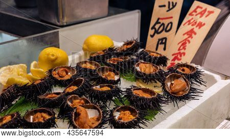 Golden Egg Urchin Open And Ready To Eat In Kyoto Fish Market. Fresh Uni Seafood