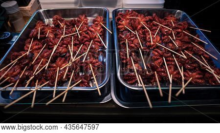 Small Octopus On The Sticks. A Delicious Traditional Japanese Street Food Snack