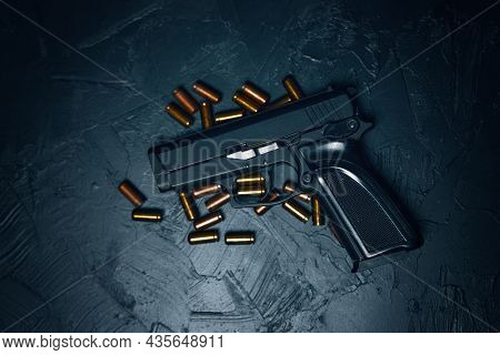 Flat Lay Of Pistol And Bullets. Firearms On Dark Background. Gun For Defense Or Attack. Concept Of C
