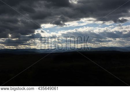 Halloween Mystery Background Landscape With A Mystical Thunderous Horror Sky Over The Black Earth.