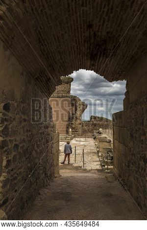 Medellin, Spain - April 28th, 2018: Roman Theatre Of Medellin. Visitor Woman Under Side Arch Entry,