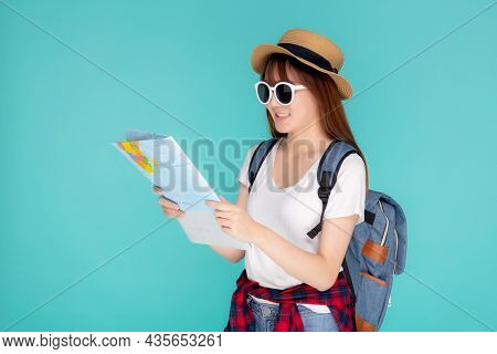 Beautiful Happy Young Asian Woman Travel Holding And Looking A Paper Map Isolated On Blue Background