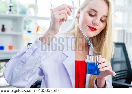 Portrait Of A Female Researcher Carrying Out Research In A Chemistry Lab Scientist Holding Test Tube