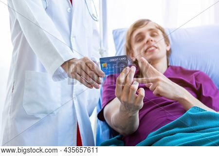 Female Doctor Therapeutic Advising And A Man Patient On Bed Abstract Blur With Focus Show Holding A