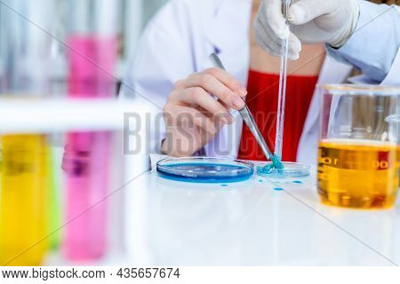 Close-up Of With Hands A Female Researcher Carrying Out Research In A Chemistry Lab Scientist Holdin
