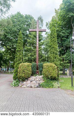 Hel, Poland - July 20, 2021: Cross On The Front Of Roman Catholic Church Of Corpus Christi In Hel.