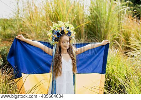 Ukraines Independence Flag Day. Constitution Day. Ukrainian Child Girl In Embroidered Shirt Vyshyvan