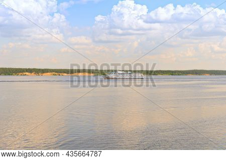 A Cruise River Ship Sails Along The Volga River On A Sunny Summer Day