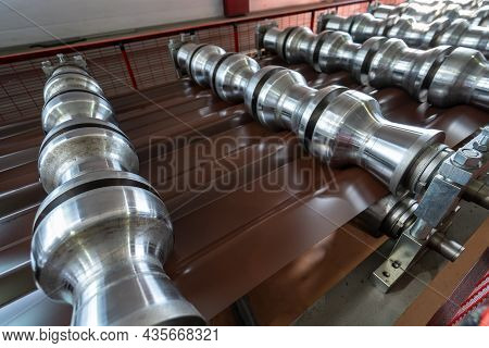 Production Line Of Metal Tile For Roof. Steel Forming Machine In Metalwork Factory Workshop. Metal S