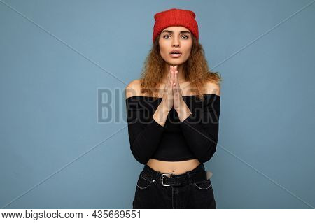Photo Of Young Beautiful Brunette Curly Woman With Sincere Emotions Wearing Black Crop Top And Red H