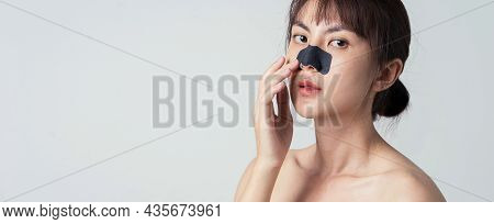 Asian Woman Model Posing On Banner And Copy Space. Beautiful Female Model With Mask Charcoal Deep Cl