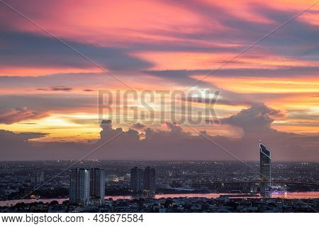 Fantastic Colorful Sunset Sky Over The Bangkok City Skyscrapers And The Bridge Crosses The Chao Phra