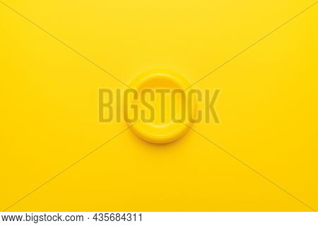 Minimalist Photo Of Yellow Pet Bowl On The Yellow Background. Overhead Image Of Empty Cat Bowl.