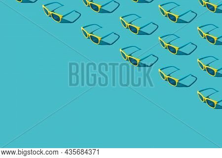 Top View Of Many Vivid Colored Plastic Sunglasses. Lots Of Sunglasses On Turquoise Blue Background W