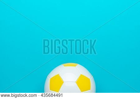 Top View Photo Of White And Yellow Football Ball As Football Concept . Minimalist Flat Lay Image Of