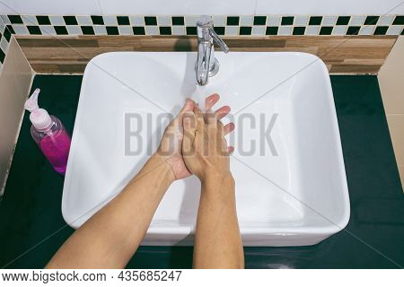 Man Are Washing Their Hands With Foam Soap And Clean Water. Wash Your Hands To Keep Them Clean And P