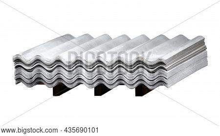 A Stack Of Wave Slate On A Wooden Flight Isolated On A White Background. Gray Wavy Slate. Slate Roof