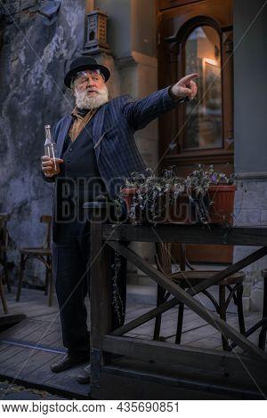 Lviv , Ukraine - 10.08.2021 : Vintage Style Clothing Elder Man Portrait In Fable Old City Urban Land