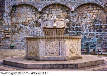 Old Fountain Near Saint Mary Collegiate Church In Kotor