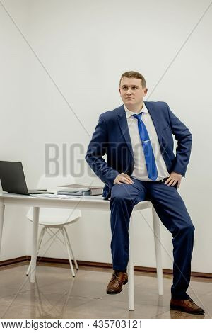 Portrait Of Concentrated Lawyer Working At Workplace With Documents In Office