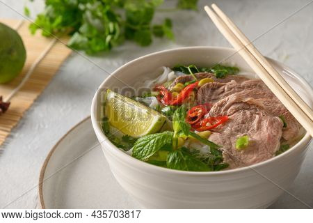 Pho Bo Soup With Beef In White Bowl On Light Backgound. Vietnamese Cuisine.