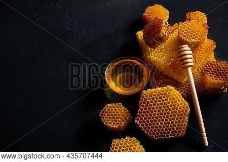 Jar Of Honey With Honeycomb On Black Table, Top View. Space For Text