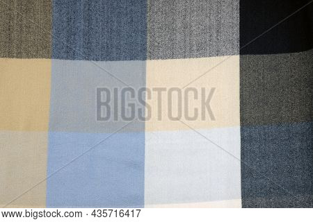Checkered Fabric Texture. Woolen Winter Scarf Background. Close-up Of Warm Soft Fabric In A Cage. Te