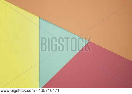 Abstract Background From Colored Paper Of Red, Yellow And Green Colors. Minimal Geometric Shapes And