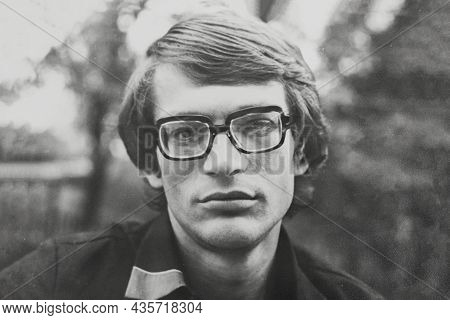Portrait Of Young Soviet Man With Glasses. Vintage Black And White Paper Photo, 1970s. Transferred P