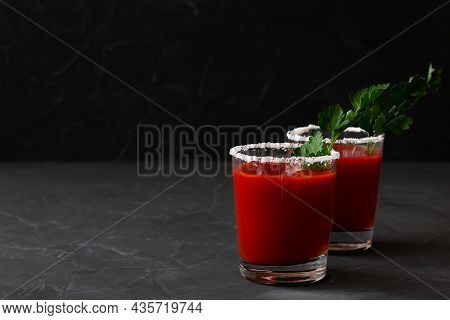 Two Glasses With Tomato Juice With Pepper, Spices, Salt And Ice In Glass With Copy Space. Bloody Mar
