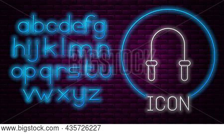 Glowing Neon Line Jump Rope Icon Isolated On Brick Wall Background. Skipping Rope. Sport Equipment.