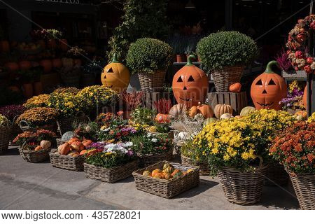 Pumpkins, Baskets With Bushes Of Bright Chrysanthemums, Beautifully Decorated Gift Baskets With Autu