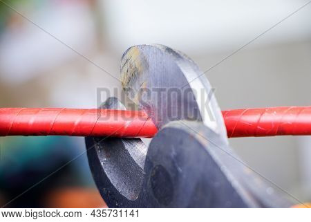 Cutting Pliers And Cable. A Cutter Is Cuting Electrical Wire Or Cable. Cutting Wires With Clippers.m