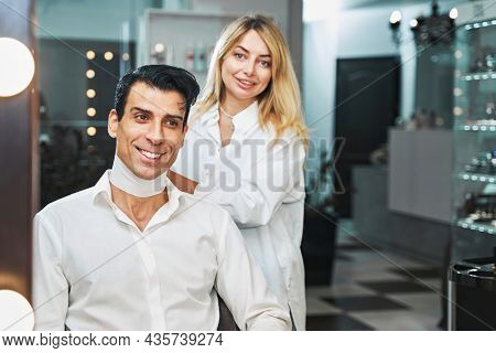 Female Hairdresser Wrapping Paper Collar Around Client Neck