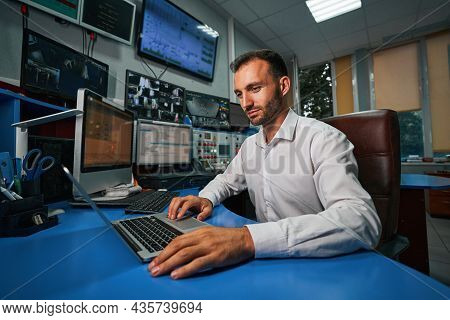 Male Server Administrator Managing Data Center From Control Room