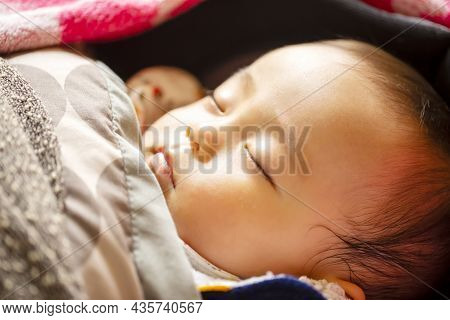 Sleeping Face Of Cute 0 Years Old Baby With Shallow Depth Of Field With Natural Light.