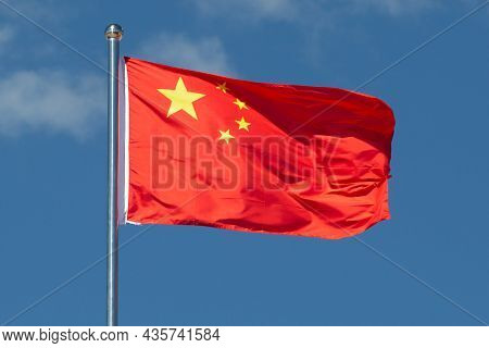 China Flag Is Waving In The Wind.