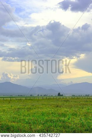 Thick Cumulus Clouds In The Evening Over The Mountain Plain. Siberia, Russia