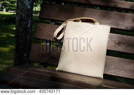 Canvas Tote Bag In The Shade Of Trees Mockup